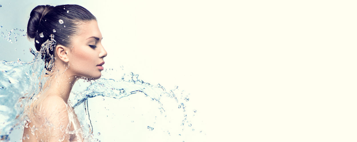 Photo of refreshed woman being gently splashed with water
